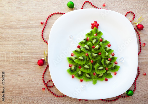 Kiwi Christmas tree - fun food idea for kids party or healthy breakfast, beautiful New Year food background