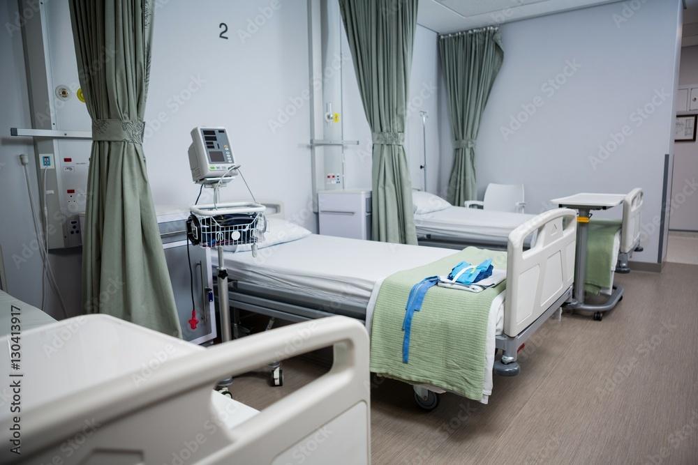 Fototapeta View of empty hospital beds in ward