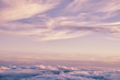 Leinwandbild Motiv Abstract background with pink, purple and blue colors clouds. Sunset sky above the clouds. Dreamy fantasy background in soft pastel colors.