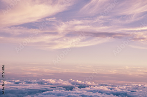 Foto op Canvas Hemel Abstract background with pink, purple and blue colors clouds. Sunset sky above the clouds. Dreamy fantasy background in soft pastel colors.