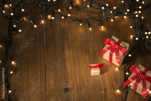 christmas gifts on wood christmas light