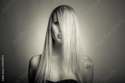 young woman with long hair and hat - black and white photo