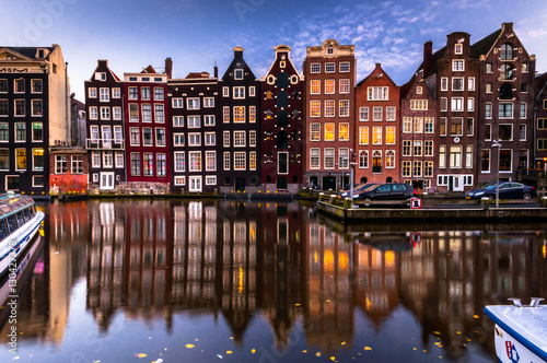 Photo Stands Amsterdam Night city view on Amsterdam canal. Facade and reflections in canal. Netherlands