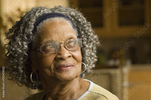 Fotografie, Obraz  Portrait of an elderly African American woman at home.