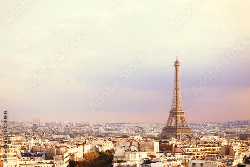 Poster Paris Sunset Eiffel tower and Paris city view form Triumph Arc. Eiffel Tower from Champ de Mars, Paris, France. Beautiful Romantic background.