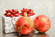 Christmas decoration. Gifts and red baubles.
