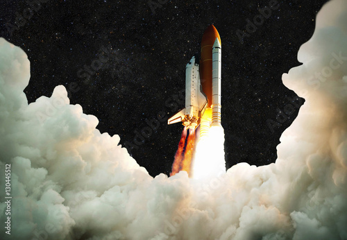 Spaceship takes off into space. Rocket flies on a background of starry sky