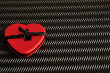 Valentine's Day. A Red Heart Tin With A Black Ribbon