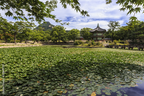 Poster Waterlelies Hyangwonjeong, hexagonal pavilion on island in water lily filled lake in summer, Gyeongbokgung Palace, Seoul, South Korea, Asia