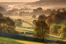 The Littondale Valley Lit By The Early Morning Light On A Misty Autumn Morning In The Yorkshire Dales, Yorkshire