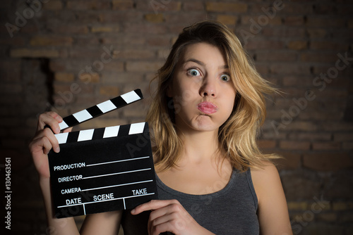 Photo  Young blonde girl with movie clapper