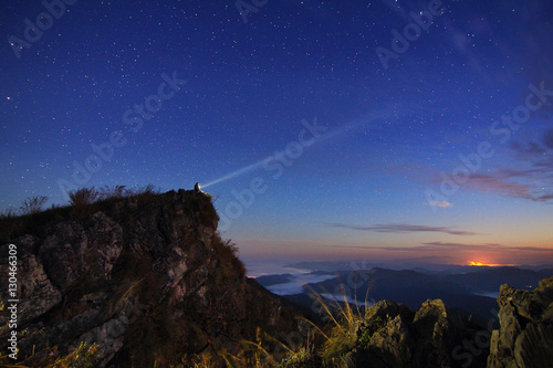 Beautiful scenery of the starry sky at night at Doi Pha Phung at Nan province in Thailand Poster