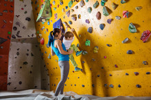 Young Female Bouldering Instru...