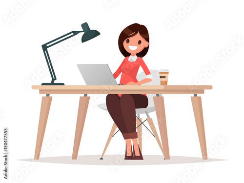 Business woman at the desk is working on the laptop computer. © tynyuk