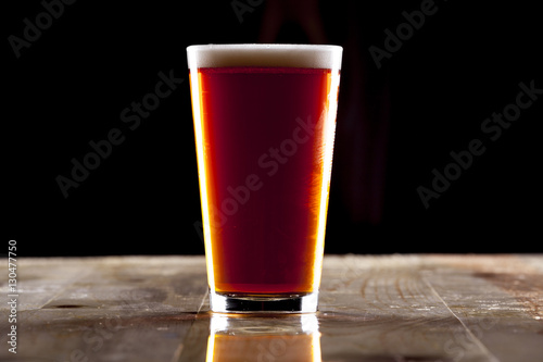 Photo  Red Amber or IPA Pint Glass of Beer