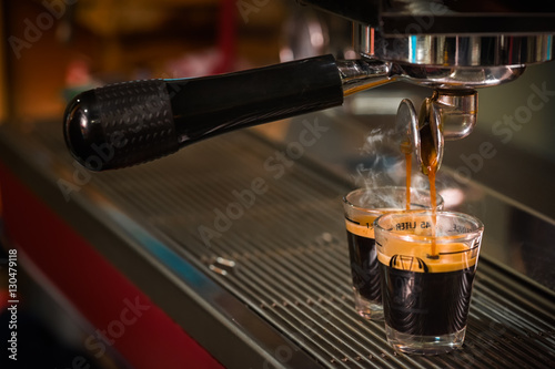 Close up image of espresso pouring into glass shot Tablou Canvas