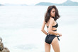 Happy woman enjoying beach relaxing joyful in summer by tropical