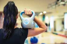 Kettlebell Fitness Training Pretty Young Woman In A Gym.