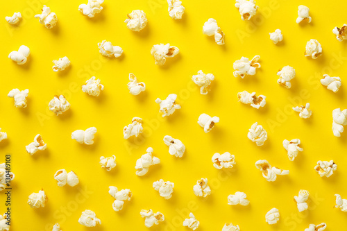 Photo  Popcorn pattern on yellow background. Top view