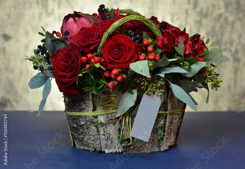 Bouquet of red roses in a box of birch bark