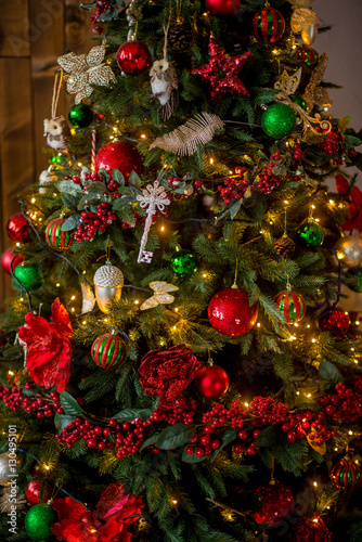 christmas tree decorated in traditional colors red green gold and christmas lights the - Why Are Red And Green Christmas Colors