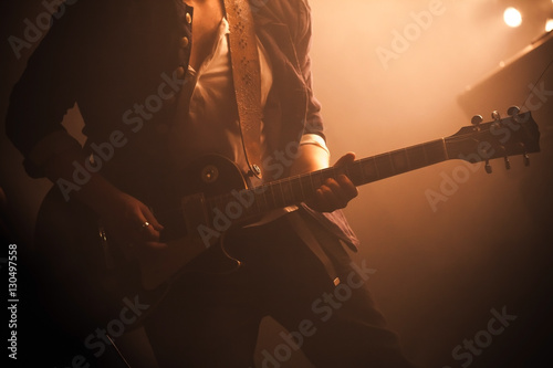 Electric guitar player on a stage - 130497558