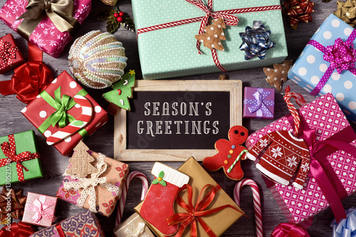 gifts, christmas ornaments and text seasons greetings Poster