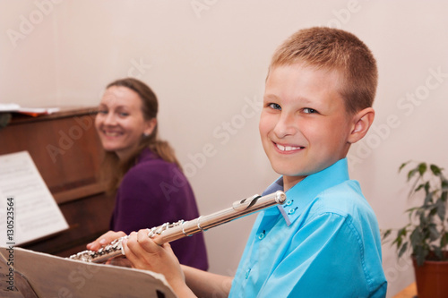 Boy playing the flute Wallpaper Mural
