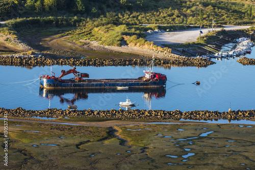 Valokuva  Boat dredging a river in Spain