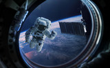 Fototapeta Kosmos - Earth planet and astronaut in space ship window porthole. Elements of this image furnished by NASA
