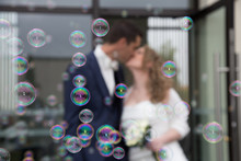 First Kiss For Wedding Couple After Celebration With Bubbles Soap