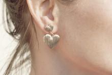 Woman Wearing A Heart Shape Earring