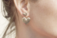 Woman Wearing A Heart Shape Ea...
