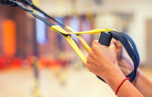 TRX. Female Hands With Fitness...