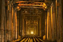 Illuminated Railroad Track In Tunnel