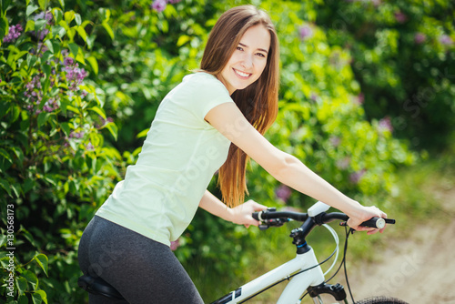 Happy Young Girl Cyclist Standing With A Mountain Bike And