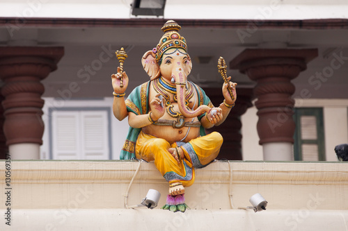 Statue of Ganesha on top of a building Canvas Print
