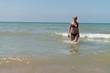 Portrait Of Blonde Woman Posing In Bikini