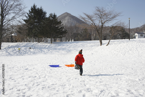 Fotografie, Obraz  A child running in the snowfield