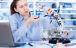 Girl in robotics laboratory. Young woman technician repair roboter manipulator