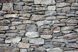 Fototapeta Kamienie - Grey stone siding with different sized stones