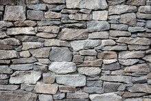 Grey Stone Siding With Different Sized Stones