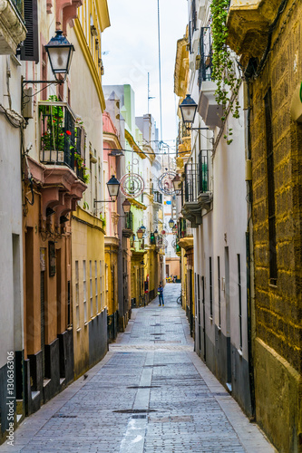 a narrow street in historical center of spanish city cadiz