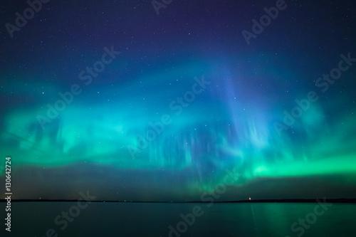 Keuken foto achterwand Noorderlicht Northern lights over lake in finland