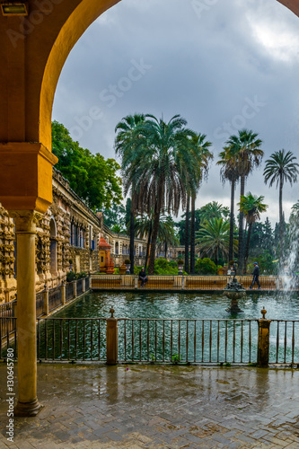 In de dag view of a fountain situated in gardens of the real alcazar palace in the spanish city sevilla.