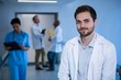 Portrait of male doctor in corridor