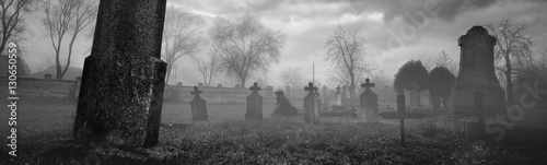 Old creepy graveyard on stormy winter day in black and white Fototapet