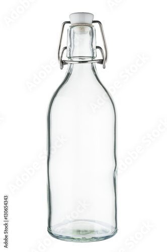 Empty glass bottle on white background