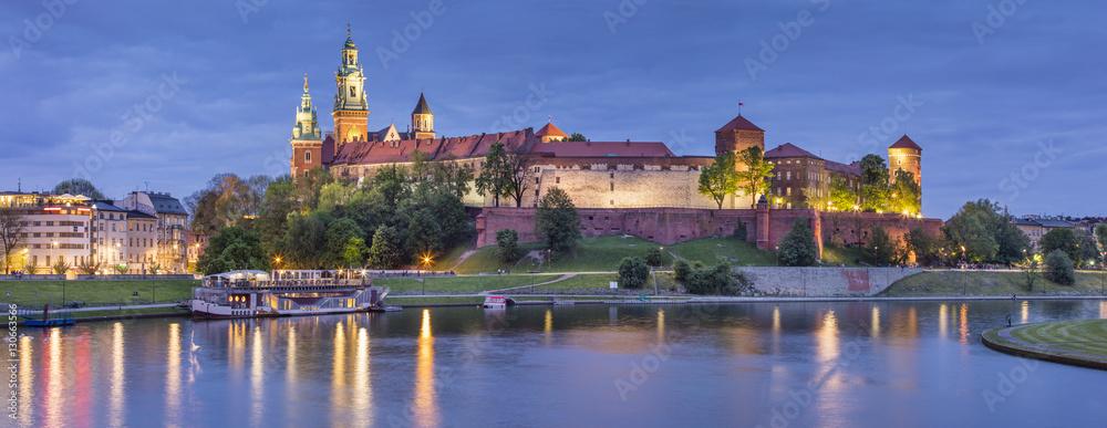 Golden lights of old castle in evening
