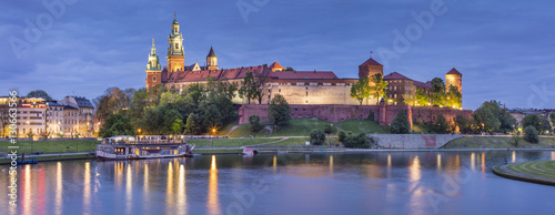 Golden lights of old castle in evening
